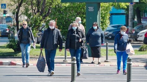 People walking in public with masks