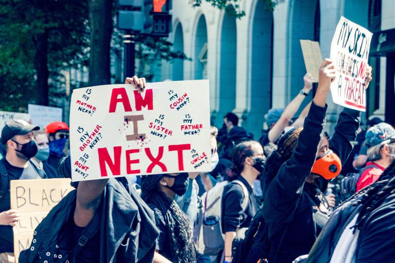 black lives matter march poster that reads  am i next