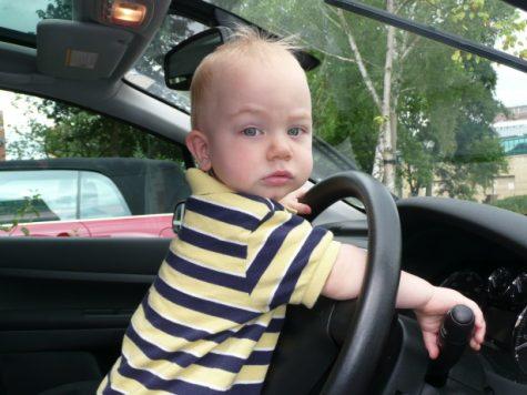 Baby behind wheel